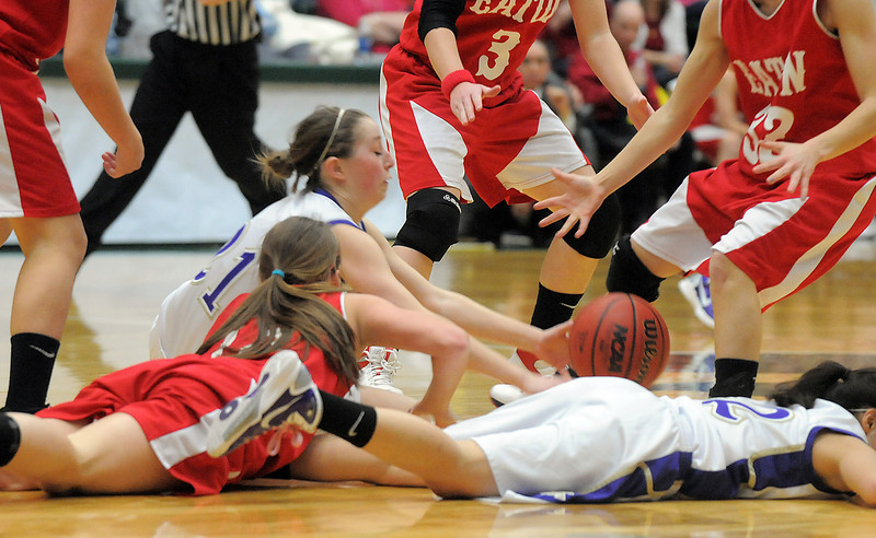 Holy Family's Sarah Talamantes tries to grab a loose ball from Eaton during the 3A state championship game at Moby Arena in Ft. Collins  on Saturday.<br /> March 12, 2011<br />  staff photo/David R. Jennings