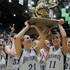 Sarah Talamantes, left, and Taylor Helbig hold up the trophy after Holy Family defeated Eaton during the 3A state championship game at Moby Arena in Ft. Collins  on Saturday.<br /> March 12, 2011<br />  staff photo/David R. Jennings