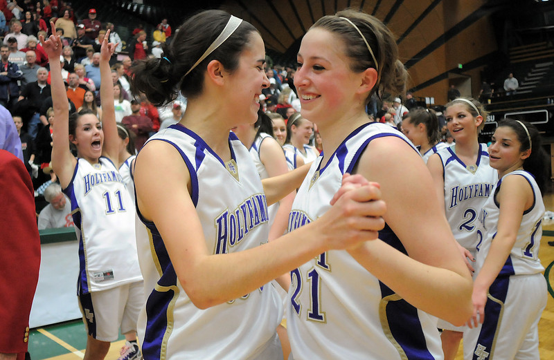 Holy Family's Sarah Talamantes, right, and Carolina Gutierrez celebrates after defeating Eaton 60-51 in the 3A state championship game at Moby Arena in Ft. Collins  on Saturday.<br /> March 12, 2011<br />  staff photo/David R. Jennings