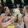 Holy Family seniors Sierra Williamson, left watches as Carolina Gutierrez kisses the trophy being held by Sarah Talamantes and Tayor Helbig defeating  Eaton for the 3A state championship at Moby Arena in Ft. Collins  on Saturday.<br /> March 12, 2011<br />  staff photo/David R. Jennings
