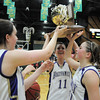 Holy Family's seniors Sierra Williamson, left, Carolina Gutierrez, Taylor Helbig and Sarah Talamantes hold the 3A state championship trophy after the game at Moby Arena in Ft. Collins  on Saturday.<br /> March 12, 2011<br />  staff photo/David R. Jennings