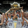 Sarah Talamantes and Taylor Helbig hold the 3A state championship trophy after Holy Family defeated Eaton on Saturday at Moby Arena in Ft. Collins. This is the team's four championship in a row.<br /> March 12, 2011<br />  staff photo/David R. Jennings