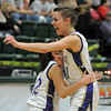 Holy Family's Tayor Helbig and Megan Chavez celebrate winning the  3A state championship game defeating Eaton at Moby Arena in Ft. Collins  on Saturday.<br /> March 12, 2011<br />  staff photo/David R. Jennings