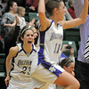 Holy Family's Carolina Gutierrez, left, and Taylor Helbig celebrate winning the 3A state championship game at Moby Arena in Ft. Collins  on Saturday defeating Eaton 60-51.<br /> March 12, 2011<br />  staff photo/David R. Jennings