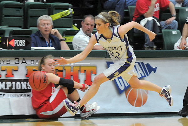 Holy Family's Stephanie Giltner drives the ball downcourt against Eaton during the 3A state championship game at Moby Arena in Ft. Collins  on Saturday.<br /> March 12, 2011<br />  staff photo/David R. Jennings