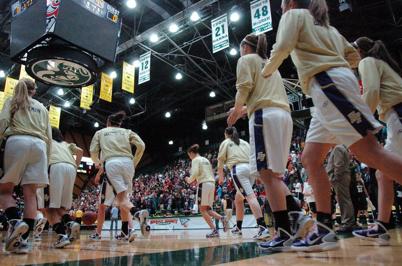The Holy Family team goes onto the floor to play Eaton in the 3A state championship game at Moby Arena in Ft. Collins  on Saturday.<br /> March 12, 2011<br />  staff photo/David R. Jennings