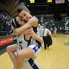 Holy Family's Taylor Helbig hugs Carolina Gutierrez after defeating Eaton for the 3A state championship game at Moby Arena in Ft. Collins  on Saturday.<br /> March 12, 2011<br />  staff photo/David R. Jennings