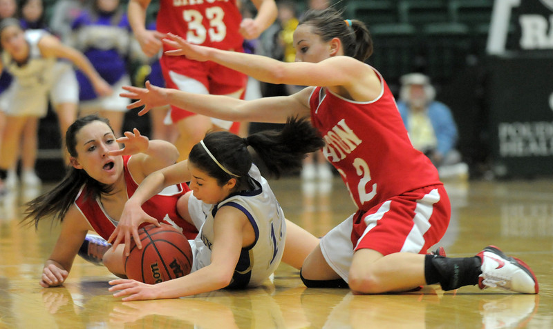 Holy Family's Megan Chavez grabs a loose ball from Eaton during the 3A state championship game at Moby Arena in Ft. Collins  on Saturday.<br /> March 12, 2011<br />  staff photo/David R. Jennings