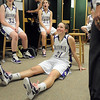 Holy Family's Sarah Talamantes sits on the locker room floor resting her back, which she injured the night before, after the team defeated Eaton in the 3A state championship game at Moby Arena in Ft. Collins  on Saturday.<br /> March 12, 2011<br />  staff photo/David R. Jennings