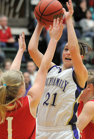 Sarah Talamantes, Holy Family, goes to the basket against Shelby Edens, Eaton during the 3A state championship game at Moby Arena in Ft. Collins  on Saturday.<br /> March 12, 2011<br />  staff photo/David R. Jennings