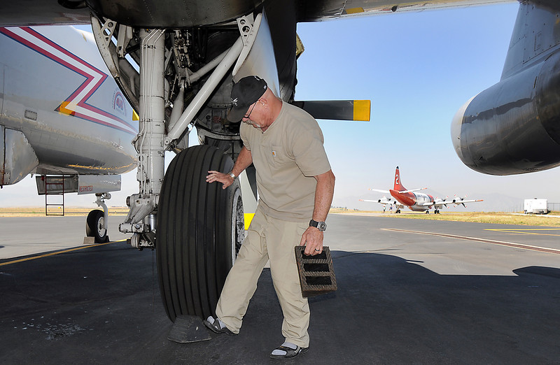 Pilot Bob Webb removes the chalks for the wheel of his P-2 airtanker at the US Forest Service Airtanker base at Rocky Mountain Metro Airport while preparing to fight the Four Mile fire in Boulder County on Tuesday. <br /> <br /> September 7, 2010<br /> staff photo/David R. Jennings