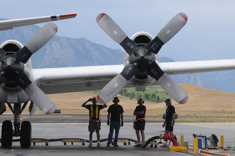 Retardant loading crew stands by to load a P-3 airtanker at the US Forest Service Airtanker base at Rocky Mountain Metro Airport.<br /> September 8, 2010<br /> staff photo/David R. Jennings