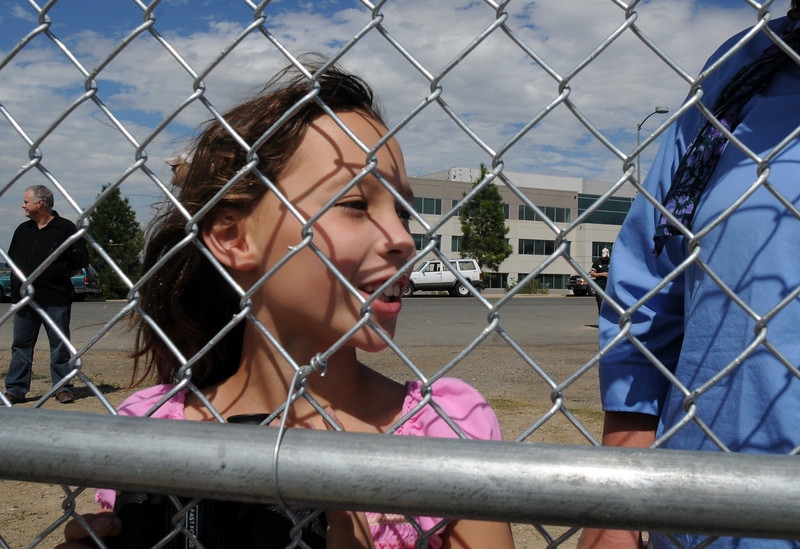 Madelene Kleinhans, 7, of Broomfield, watches airtankers at the US Forest Service Airtanker base at Rocky Mountain Metro Airport while the planes fight the Fourmile Canyon Fire in Boulder County on Wednesday. <br /> <br /> September 8, 2010<br /> staff photo/David R. Jennings