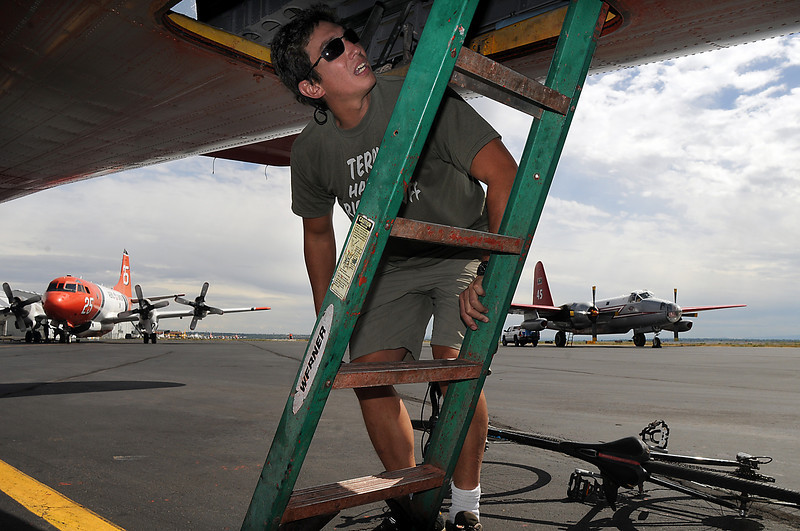 Co-pilot Dave Tolle prepares to climb on board his P-2V airtanker to fight the Fourmile Canyon Fire in Boulder County at the US Forest Service Airtanker base at Rocky Mountain Metro Airport  on Wednesday. <br /> <br /> September 8, 2010<br /> staff photo/David R. Jennings