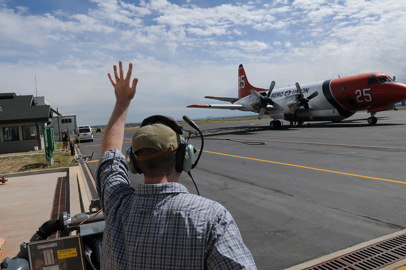 Retardant mix master signals the loading crew at the US Forest Service Airtanker base at Rocky Mountain Metro Airport.<br /> <br /> September 8, 2010<br /> staff photo/David R. Jennings