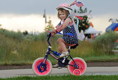 Rebeca Reisdorf, 3, riding the the bike parade during Broomfield's Great American Picnic at County Commons Park.  July 4, 2009 staff photo/David Jennings