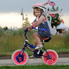 Rebeca Reisdorf, 3, riding the the bike parade during Broomfield's Great American Picnic at County Commons Park.<br /> <br /> July 4, 2009<br /> staff photo/David Jennings