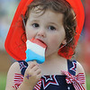 Kathleen Riggin, 2, eating an  ice cream bar during Broomfield's Great American Picnic at County Commons Park.<br /> <br /> July 4, 2009<br /> staff photo/David Jennings