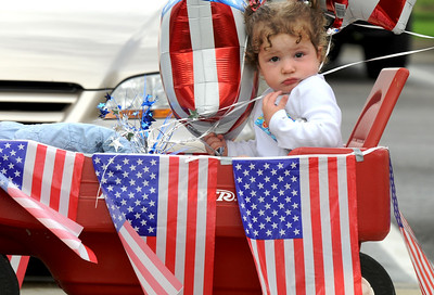 Emily Shefchik, 20 months-old, rode in her decorated wagon in the bike parade during Broomfield's Great American Picnic at County Commons Park.  July 4, 2009 staff photo/David Jennings