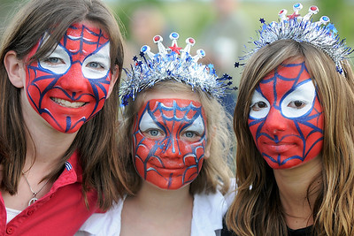 Sisters Brianna Lyons, 11, left, Haylee Rezendes, 9, and Noel Carter, 12, show off their decorated faces during Broomfield's Great American Picnic at County Commons Park.  July 4, 2009 staff photo/David Jennings