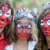 Sisters Brianna Lyons, 11, left, Haylee Rezendes, 9, and Noel Carter, 12, show off their decorated faces during Broomfield's Great American Picnic at County Commons Park.<br /> <br /> July 4, 2009<br /> staff photo/David Jennings