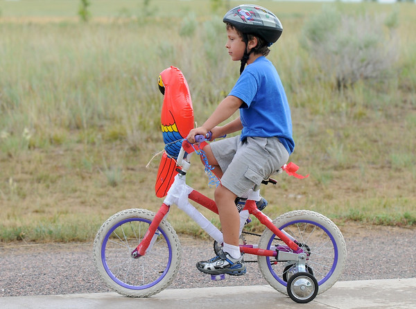 Parker Zarecki, 5, decorated his bike with a parrot for the bike parade during Broomfield's Great American Picnic at County Commons Park.<br /> <br /> July 4, 2009<br /> staff photo/David Jennings