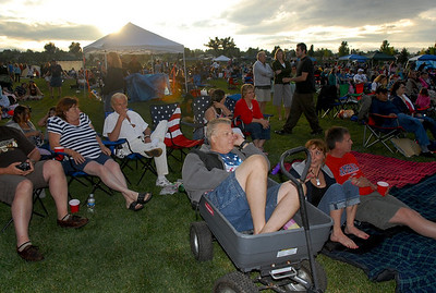 Stan Salzman, center, sits in a wagon to listen to the Nacho Men concert during Broomfield's Great American Picnic at County Commons Park.  July 4, 2009 staff photo/David Jennings