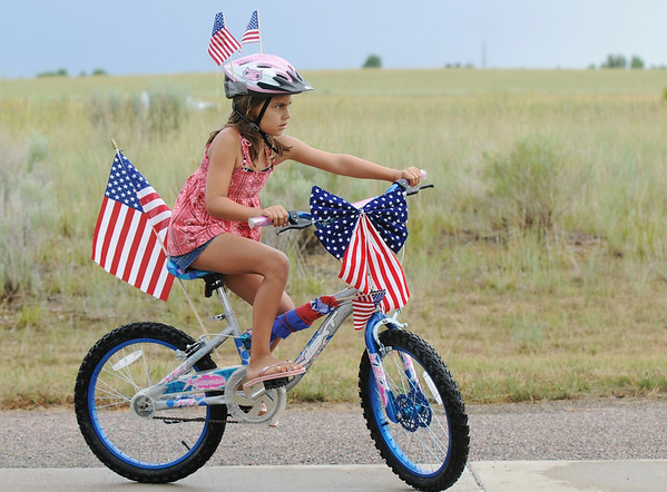 Erica Haines, 8, riding in the bike parade during Broomfield's Great American Picnic at County Commons Park.<br /> <br /> July 4, 2009<br /> staff photo/David Jennings