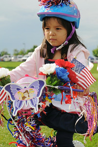 Isabella Martinez, 5, riding in the bike parade during Broomfield's Great American Picnic at County Commons Park.  July 4, 2009 staff photo/David Jennings