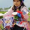 Isabella Martinez, 5, riding in the bike parade during Broomfield's Great American Picnic at County Commons Park.<br /> <br /> July 4, 2009<br /> staff photo/David Jennings