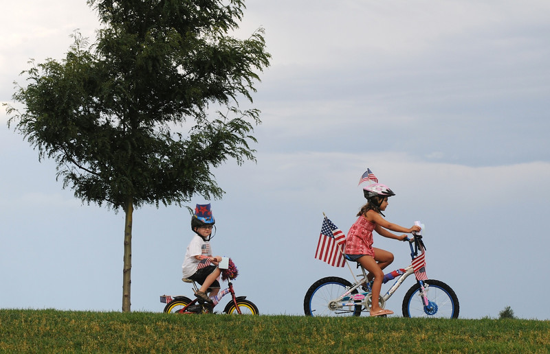 Erica Haines, 8, right, and Blaine Krug, 4 1/2, lead the bike parade with about 100 participants during Broomfield's Great American Picnic at County Commons Park.<br /> <br /> July 4, 2009<br /> staff photo/David Jennings