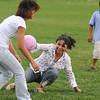 Silvia Acevedo, center tries to tag out her daughter Nezly, 16, as her son Jesus, 8, watches during an improvised game of baseball during Broomfield's Great American Picnic at County Commons Park.<br /> <br /> July 4, 2009<br /> staff photo/David Jennings