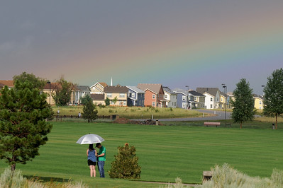 A rainbow shows after the rainstorm at Broomfield's Great American Picnic at County Commons Park.  July 4, 2009 staff photo/David Jennings