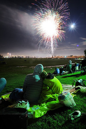 Spectators watch he fireworks display from Broomfield County Commons Park as the finale to Broomfield's Great American Picnic.<br /> <br /> July 4, 2009<br /> staff photo/David Jennings