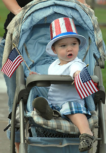 Jordan Coppo, 2, rides in his patriotic stroller during Broomfield's Great American Picnic at County Commons Park.  July 4, 2009 staff photo/David Jennings