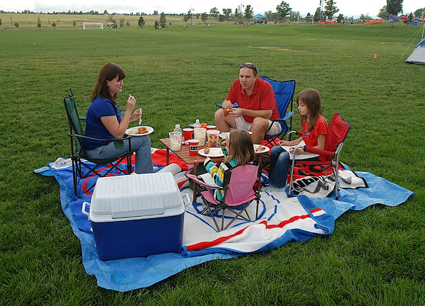 The Stenger family of Scott,center, Debbie, left,  Emily, 6, and Anna, 9, have their picnic before the fireworks during Broomfield's Great American Picnic at County Commons Park.<br /> <br /> July 4, 2009<br /> staff photo/David Jennings