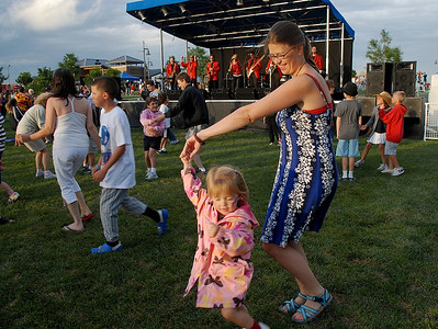 Cari Schnepp dances with her daughter Bella, 3, to the music of the Nacho Men during Broomfield's Great American Picnic at County Commons Park.  July 4, 2009 staff photo/David Jennings