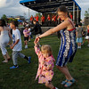 Cari Schnepp dances with her daughter Bella, 3, to the music of the Nacho Men during Broomfield's Great American Picnic at County Commons Park.<br /> <br /> July 4, 2009<br /> staff photo/David Jennings