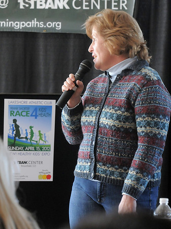 Kim Moroze chats about how Healthy learning Paths has helped her preschoolers at Emerald Elementary School during the kick-off conference for the Frank Shorter's Race 4 Kids' Health fundraiser for Healthy Learning Paths at the 1st BankCenter on Thursday.<br /> February 2, 2012<br /> staff photo/ David R. Jennings