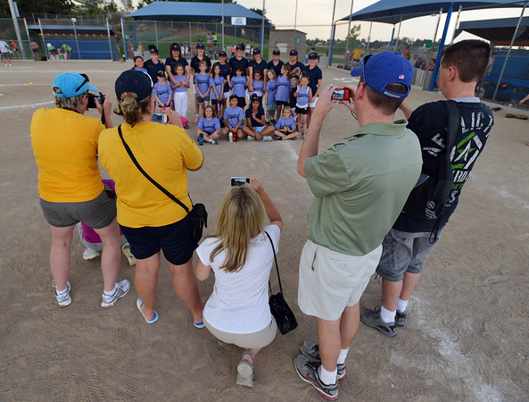 "Friends and family take pictures of the  Springwood Stingers from Brisbane Australia with the Dirt Divas after the Adopt-A-Team Program game to start the Colorado Freedom Invitational Softball Tournament at the Community Park ballfields on Friday.<br /> <br /> June 29, 2012<br /> staff photo/ David R. Jennings<br /> <br /> for more photos please go to  <a href=""http://www.broomfieldenterprise.com"">http://www.broomfieldenterprise.com</a>"