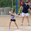 Stephanie Earley, 14, right, with the Springwood Stingers from Brisbane Australia watches  Kamryn Hayes, 7, take a swing during the Adpot-A-Team Program game to start the Colorado Freedom Invitational Softball Tournament at the Community Park ballfields on Friday.<br /> <br /> June 29, 2012<br /> staff photo/ David R. Jennings