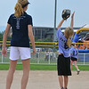 "Tianah List, 13, left, with the Springwood Stingers from Brisbane Australia watches Taylor Messen, 7, catch the ball  during the Adopt-A-Team Program game to start the Colorado Freedom Invitational Softball Tournament at the Community Park ballfields on Friday.<br /> <br /> June 29, 2012<br /> staff photo/ David R. Jennings<br /> <br /> for more photos please go to  <a href=""http://www.broomfieldenterprise.com"">http://www.broomfieldenterprise.com</a>"