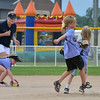 "Stephanie Earley, 14, left, with the Springwood Stingers from Brisbane Australia, watches Michaela Woods, 8, pick up the ball while teammates Taylor Melssen, 7, and Emily Kirk, 7, get to second base  during the Adopt-A-Team Program game to start the Colorado Freedom Invitational Softball Tournament at the Community Park ballfields on Friday.<br /> <br /> June 29, 2012<br /> staff photo/ David R. Jennings<br /> <br /> for more photos please go to  <a href=""http://www.broomfieldenterprise.com"">http://www.broomfieldenterprise.com</a>"