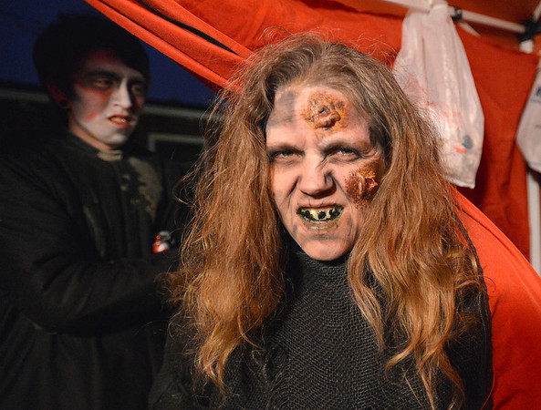 Frightmare Compound actor Cristy Nadelen shows off her face after makeup before performing in the haunted house at 108th and Old Wadsworth opens on Friday night.<br /> <br /> October 5, 2012<br /> staff photo/ David R. Jennings