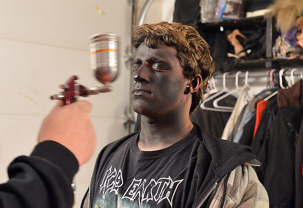 Frightmare Compound actor Nate Rosser has his face spray painted black for one step in the makeup process before the haunted house opens on Friday night.  the makeup artists have 40 actors to get ready in an hour.<br /> <br /> October 5, 2012<br /> staff photo/ David R. Jennings