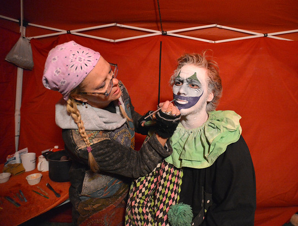"Frightmare Compound actor Brenden ""Jake"" Robinson has his clown makeup put on by artist Jackie Stemarie before performing in the haunted house at 108th and Old Wadsworth opens on Friday night.<br /> October 5, 2012<br /> staff photo/ David R. Jennings"