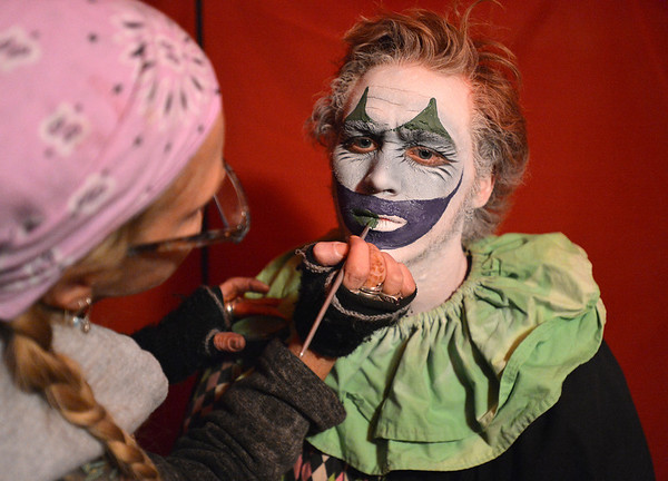 """Frightmare Compound actor Brenden """"Jake"""" Robinson has his clown makeup put on by artist Jackie Stemarie before performing in the haunted house at 108th and Old Wadsworth opens on Friday night.<br /> October 5, 2012<br /> staff photo/ David R. Jennings"""