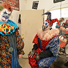 Frightmare Compound actors David Techmanski, left, and Rodrigo Fernandez prepare for their parts as bad clowns in the green room before the haunted house  opens on Friday night.<br /> <br /> October 5, 2012<br /> staff photo/ David R. Jennings