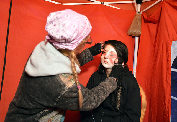 Frightmare Compound makeup artist Jackie Stemarie, left, does Sarah Moraves makeup  for her performance of the zombie bride before the haunted house opens on Friday night.<br /> October 5, 2012<br /> staff photo/ David R. Jennings