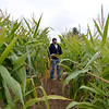 Frightmare Compound owner Josh Holder checks over the compound corn field making adjustments  before the haunted house opens on Friday night. <br /> October 5, 2012<br /> staff photo/ David R. Jennings